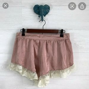 Pink ruffle shorts from Urban Outfitters